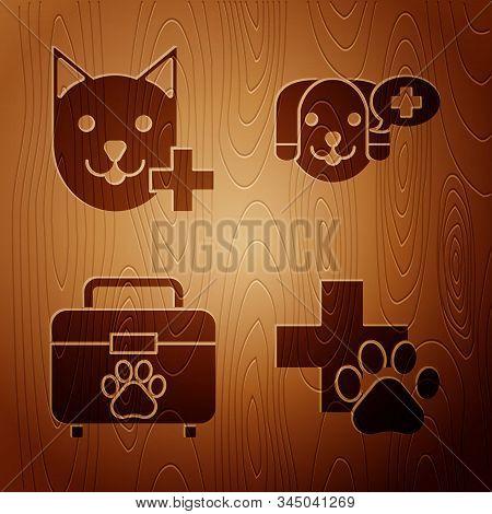 Set Veterinary clinic symbol, Veterinary clinic symbol, Pet first aid kit and Veterinary clinic symbol on wooden background. Vector stock photo