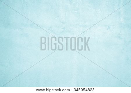 Blue concrete wall of light blue color, Dark blue marble or cracked concrete background as an abstract mystical background or marble or concrete texture. Abstract Grunge Decorative Relief Navy Blue Stucco Wall Texture. Wide Angle Rough Colored Background. stock photo