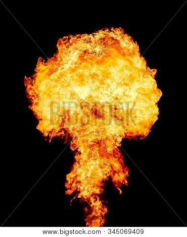 Explosion - fire mushroom. Mushroom cloud fireball from an explosion at night. Nuclear explosion. Symbol of environmental protection and the dangers of nuclear energy stock photo