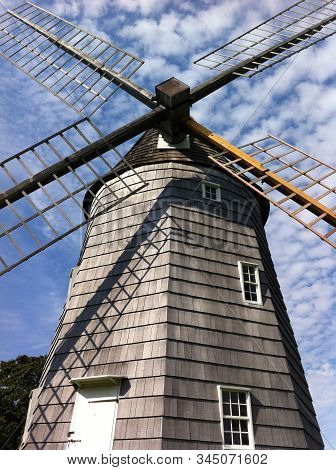 Low angle picture of the beautiful Hook Windmill (also as Old Hook Mill) is a historic Windmill built in 1806 and located in East Hampton, New York, United States stock photo