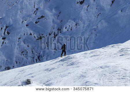 Professional climber goes under the rock. Young active human hiking in Low Tatras in Slovakia. Active lifestyle. Adventurer in the middle of nowhere. Expedition on Chopok hill. Concept of freedom stock photo