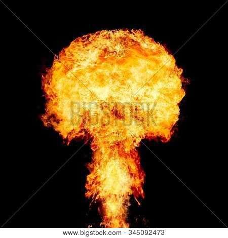 Explosion - fire mushroom. Mushroom cloud fireball from an explosion at night. Nuclear explosion. Symbol of environmental protection and the dangers of nuclear energy. stock photo