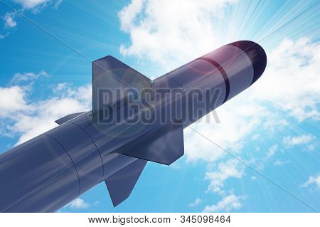 Military tactical missile against the sun's rays and blue peaceful sky. 3D rendering, illustration. stock photo