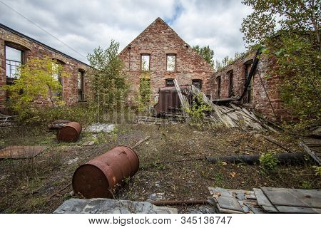Exterior Of Abandoned Industrial Complex. Exterior of abandoned building at the Keweenaw National Historic Park. The park focuses on the rise and fall of the copper mining industry in the Keweenaw stock photo