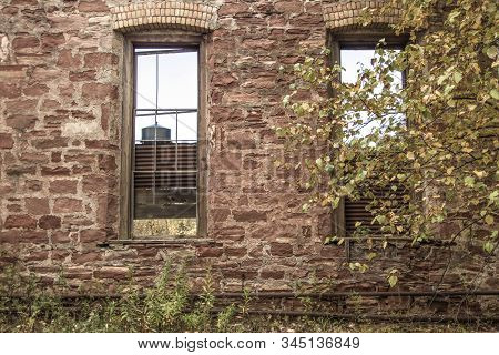 Exterior Of Abandoned Industrial Complex. Exterior of abandoned building at the Keweenaw National Historic Park. The park focuses on the rise and fall of the copper mining industry. stock photo