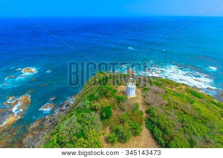 Aerial view of the cliffs landscape along shipwreck coast in ocean of Bass Strait from Cape Otway Lighthouse. Attraction along Great Ocean Road in Victoria, Australia. stock photo