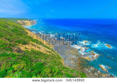 Aerial view of wild cliffs landscape along shipwreck coast in ocean of Bass Strait from Cape Otway Lighthouse. Attraction along Great Ocean Road in Victoria, Australia. stock photo
