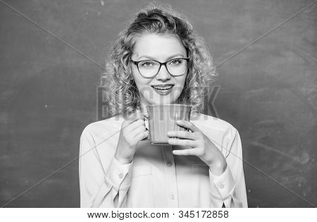 morning coffee. good morning. girl refreshing with tea drink. idea and inspiration. energy and vigor. energy reserves refill. woman with coffee cup at blackboard. school teacher need coffee break stock photo