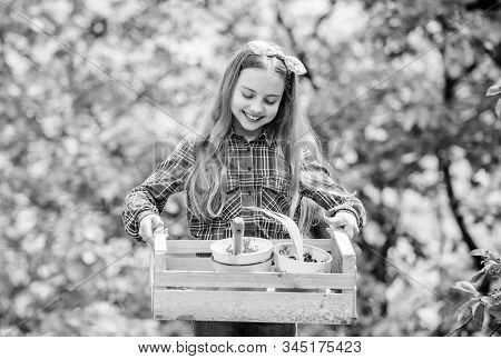 Popular garden care. Inspect garden daily spot insect trouble early. Gardening classes. Ecology education. Little girl planting plants. Day at farm. Planting flowers. Plant veggies. Planting season stock photo