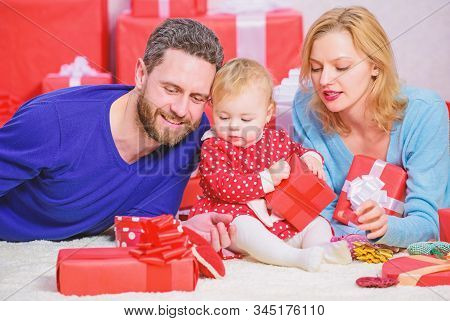 Celebrating something special. Traditional family values. Family celebrate anniversary. Valentines day. Lovely family celebrate valentines day. Happy parents. Couple in love and baby are happy family stock photo