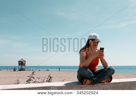 beautiful girl with the phone in his hand stock photo