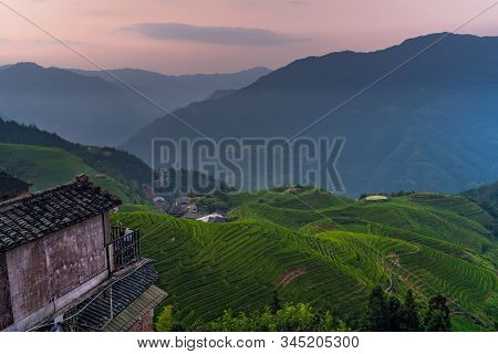 Sunset over Seven Stars Accompany the Moon cascading layered Rice Terraces forming part of Longji Rice Terraces, Pingan village, northern Guilin, Guangxi Zhuang Autonomous Region aka Guangxi Province, China stock photo