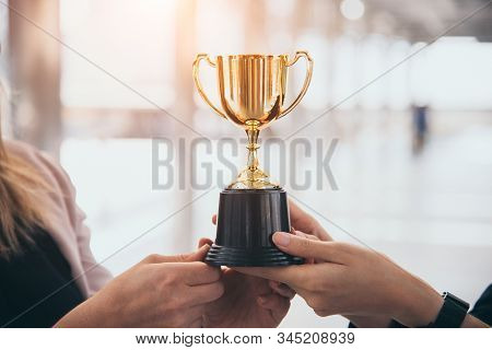 Champion golden trophy for winner background. Success and achievement concept. Sport and cup award theme. Best business entrepreneur and startup award and prize. First place on final competition stock photo