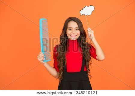 Inspiration creating hairstyle. Idea for hair. Get rid of annoying tangles. Girl long hair hold comb and speech bubble. Hairdresser salon. Combing hair. Styling tips. Tangled hair. Communication. stock photo
