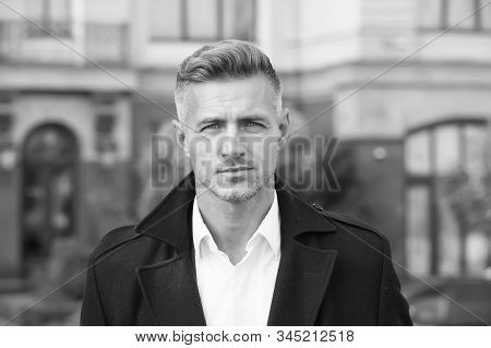 Facial care and ageing. Beauty of mature face. Traits and behaviors that make men more appealing. Attractive mature man. Mature guy with grey hair and bristle. Men get more attractive with age. stock photo