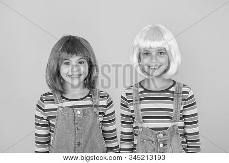 Anime culture influence. Invitation for anime party. Happy little girls smiling faces. Anime fan. Cheerful friends in bright colorful wigs. Anime cosplay party concept. Happy childhood concept. stock photo