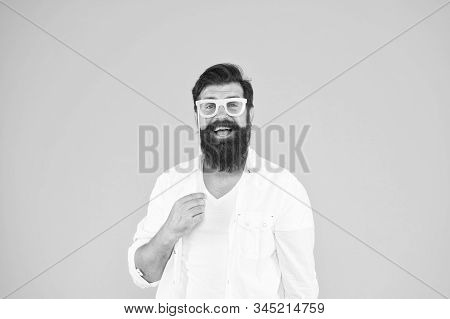 Party accessory. Good mood. Holiday celebration. Smart nerd eyeglasses. Last minute costume party ideas. Bearded man happy to join party. Guy with beard and mustache hold eyeglasses photo booth prop. stock photo