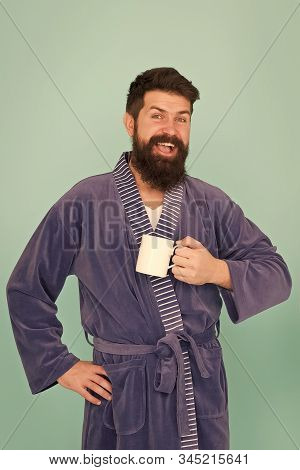 start off in morning. everyday routine begins from coffee. need some energy. tea time at home. happy morning. morning man in bathrobe drink coffee. bearded hipster man coffee cup. he feel rested. stock photo