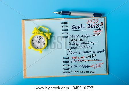 Goals 2020, To do list, plans on the desktop. Achievements and Failures New Year concept - 2020 stock photo