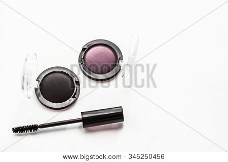 Cosmetic branding, blog and girly concept - Eyeshadows, black liner and mascara on marble background, eye shadows cosmetics as glamour make-up products for luxury beauty brand, holiday flatlay design stock photo