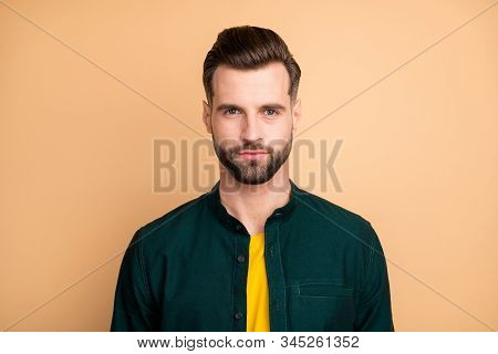 Closeup photo of amazing macho guy serious perfect appearance neat hairstyle bristle young promoted boss chief wear casual outfit isolated beige pastel color background stock photo