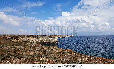 View of the deserted sandy beach on a Sunny day. Beautiful seascape of Black sea coast. Travel background. Western coast of Crimea. stock photo