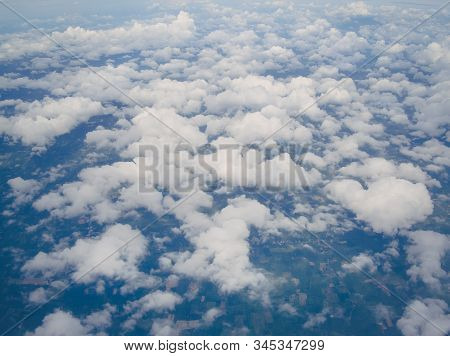 Aerial view of clouds cape with blue sky, Clouds from above. A view from airplane. stock photo