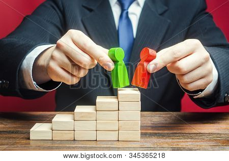 Businessman decides to choose which candidates for a leadership position. Head Offset. Business optimization, replacement of old employees with new loyal. Change of power. HR management. Staff update stock photo