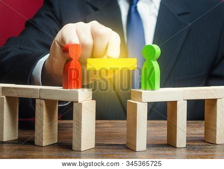 A man mediates in the negotiation process. Compromise and dispute resolution. Build bridges improve relationships. Communication mediation between conflicting parties. escape escalations of conflicts stock photo