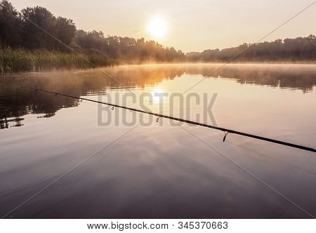 Silent sunset fishing. Fishing on the inflatable boat on the river an sinrise in early morning. Inflatable kayak with rod with spoon in the summer day on the river. Leisure on water. Activities outdoor. Fishing from a boat. Handheld shot oning boat. Fishi stock photo