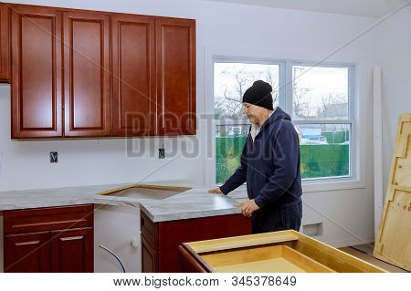 Kitchen counter top in a kitchen carpenter installing cabinets more functional with kitchen counter top stock photo