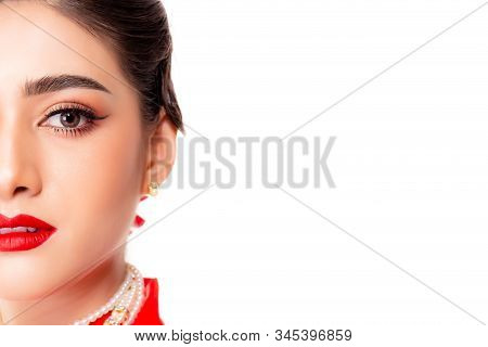 Close up Beautiful make up on asian woman face. Asia woman apply beautiful makeup on her beautiful face. Attractive young lady put red lipstick on her lips. Isolated on white background, copy space stock photo