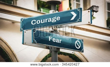 Street Sign the Direction Way to Courage versus Fear stock photo