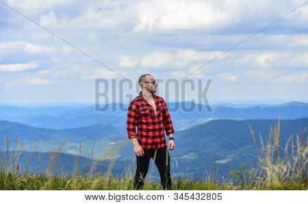 Achieve freedom. Free and wild. Value of freedom. Self sufficient. Man stand on top of mountain. Hiking concept. Active leisure. Guy enjoy freedom. Discover world. Masculinity and male energy stock photo