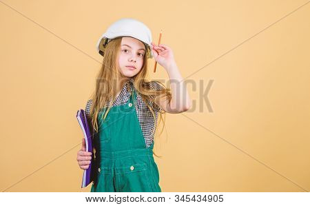 Control renovation process. Kid happy renovating home. Home improvement activity. Kid girl planning renovation. Child renovation room. Family remodeling house. Create room you always dreamed stock photo