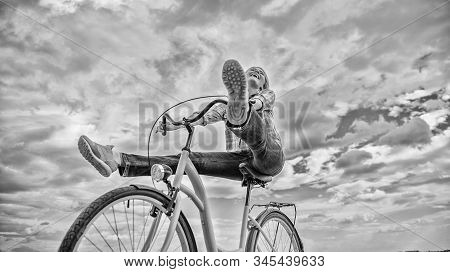 Woman feels free while enjoy cycling. Girl rides bicycle sky background. Cycling gives you feeling of freedom and independence. Most satisfying form of self transportation. Carefree and satisfied stock photo