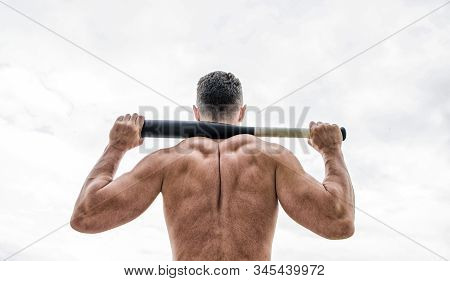 Attack and defence. Get ready attack. Man with baseball bat. Hooligan hits bat. Victory requires payment in advance. Bandit aggression anger. Muscular man fighting. Violence and attack. Street fight stock photo