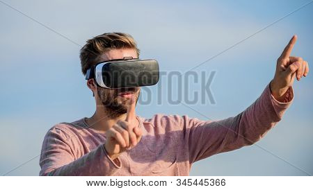 Cyber space. Game online. Man wear wireless VR glasses headset. Augmented reality. Use modern technology. Engineering project. Virtual reality goggles. Digital future and innovation. Virtual reality stock photo