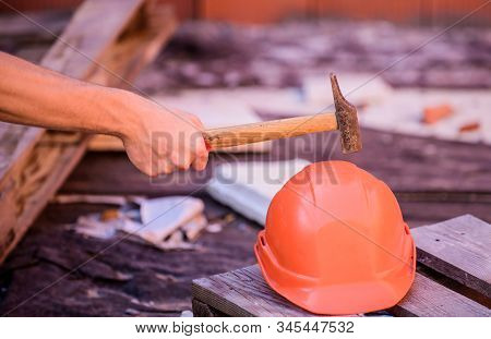 Protective helmet. Material strength. Building construction. Professional hard hat. Engineer architect repairer safety accessory. Helmet or hard hat. Hammer knocking helmet close up. Test concept stock photo