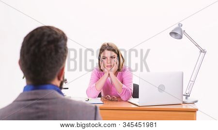 Fully engaged. Man applying for job. Human resource manager conducting job interview. Female boss making decision about job applicant. Pretty interviewer talking with job candidate in HR department stock photo