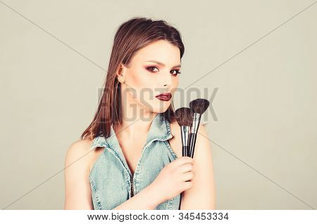 sexy woman with professional make up brush. fashion makeup visage. sexy woman with long hair, style. sexuality. skincare cosmetics. beauty hairdresser salon. Lipstick and eyeshadow. i am sexy stock photo