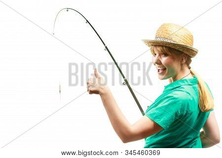 Fishery, spinning equipment, angling sport and activity concept. Woman with fishing rod showing thumb up gesture. stock photo