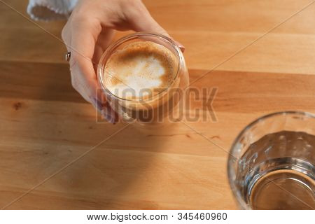Woman with aromatic coffee at table in cafe, above view stock photo