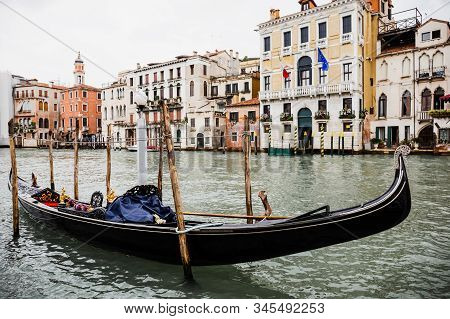 canal with gondola and ancient buildings in Venice, Italy stock photo