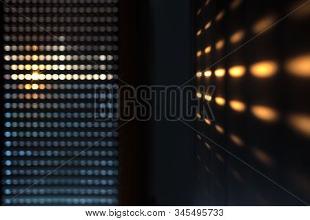 Shutters - blinds with sunlight in the morning. Dark wooden window with blinds. Interior abstract design of living room with window horizontal blinds. Soft focus abstract background stock photo