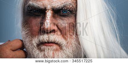 Devil vampire man. Halloween bearded man with blood make-up. Halloween man with Blood make up. Halloween art Blood skin man face portrait - close up stock photo