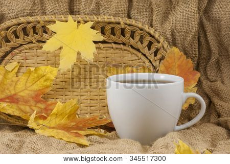 Coffee mug with autumn fall leaves on autumn background. stock photo, close up stock photo