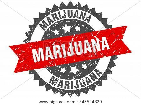 marijuana grunge stamp with red band. marijuana stock photo