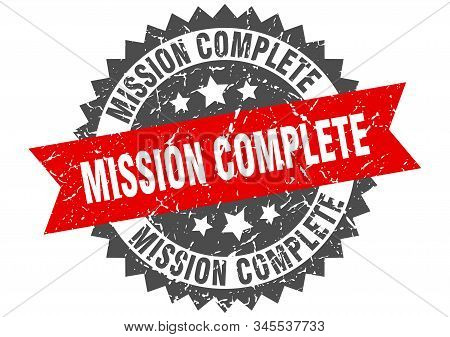 mission complete grunge stamp with red band. mission complete stock photo