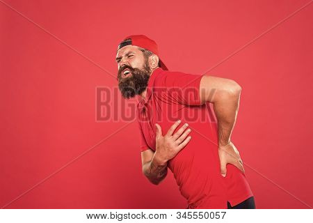 My back hurts. bearded man pain in back. barista tired and back pain after work. need massage. health care concept. barber feel hurt. terrible ache in spine. problems with health. exercises for back. stock photo